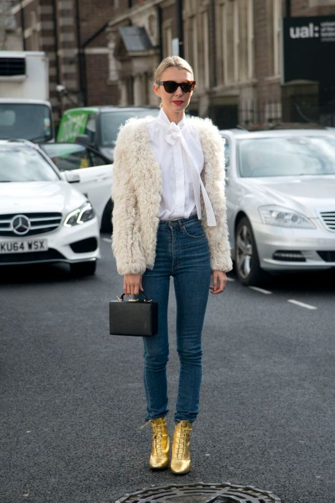 LONDON, ENGLAND - FEBRUARY 24: Founder of Avenue 32 Roberta Banteler wears Saint Laurent boots, a Mark Cross bag, Isabel Marant jacket, Celine sunglasses, Yves saint Laurent shirt and Saint Laurent jeans on February 24, 2015 in London, England. (Photo by Kirstin Sinclair/Getty Images)*** Local Caption *** Roberta Banteler